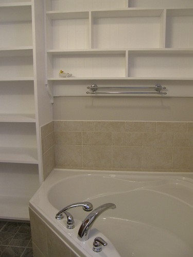 Bathroom with white shelving